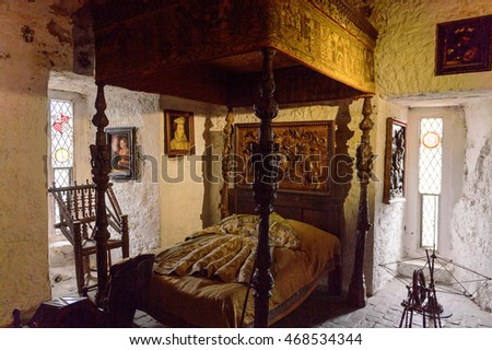 BUNRATTY, IRELAND - JULY 13, 2016: Bed in the Bunratty Castle, County Clare, Ireland. National Monument of Ireland