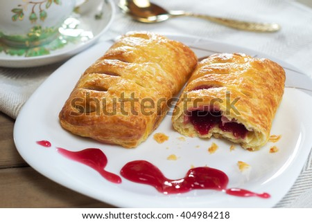 Buns Fagotinni with berry filling. Shallow DOF - stock photo