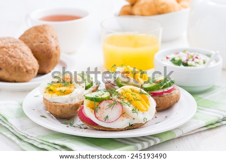 buns with egg and vegetables for breakfast, horizontal - stock photo