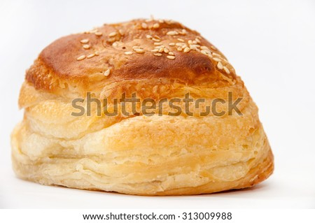 Buns with sesame seeds on the white background.