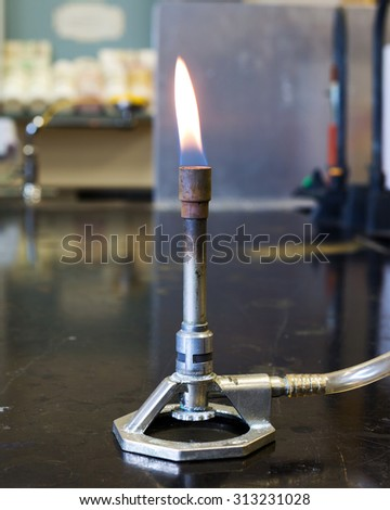 Bunsen Burner in a chemistry laboratory. - stock photo