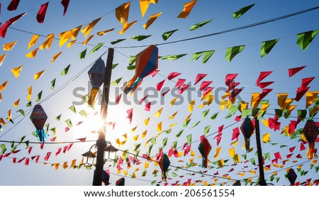 Bunting, colorful party flags, on a blue sky. - stock photo