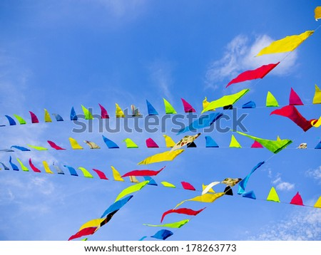 Bunting Flags Blowing in the Wind Against A Blue Sky