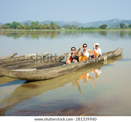 BUON ME THUOT, VIET NAM- FEB 25: Traveller travelling on Lak Lake, caucasian tourist on rowing boat, wear life jacket, people happy with view at nature, Buonmethuot, Vietnam, Feb 25, 2015