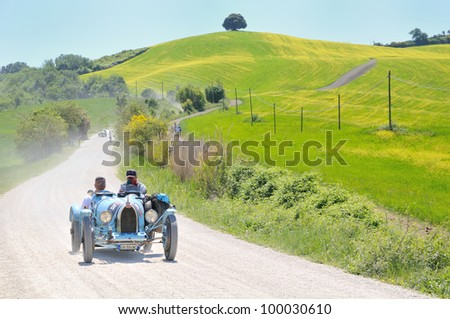 BUONCONVENTO (SI), ITALY - MAY 14 : A 1925 built light blue BUGATTI Type 35 driven by Giacomo Foglia  during a time trial at 1000 Miglia race on May 14, 2011 near Buonconvento (Siena) - stock photo