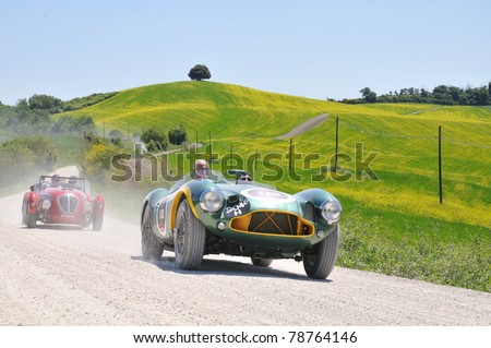 BUONCONVENTO (SIENA), ITALY - MAY 14: Vintage cars (1952 Jaguar C-Type, 1954 Mercedes Gullwing) driven by Frankel-Fowler and Binder-Capparoni at 1000 Miglia race on May 14, 2011 in Buonconvento, Italy - stock photo