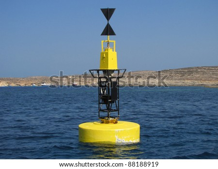 Buoy in the channel between the maltese islands - stock photo