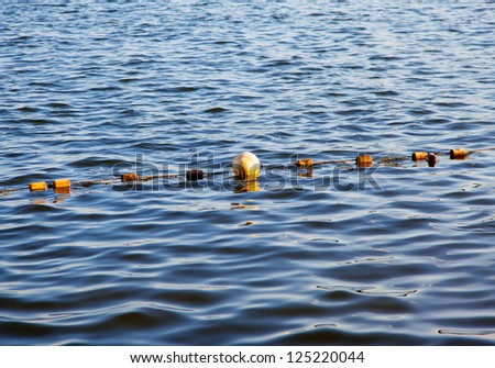 Buoy on water - stock photo