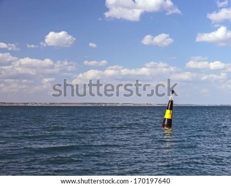 Buoy yellow black in harbor the Black sea - stock photo