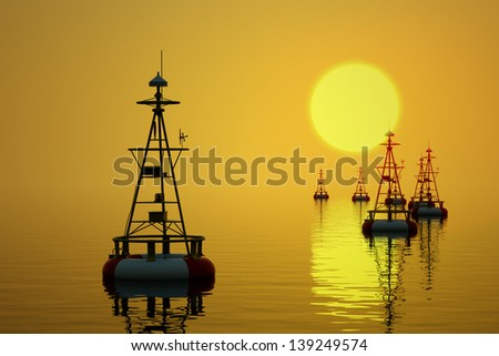 Buoys floating on the sea at the setting sun.