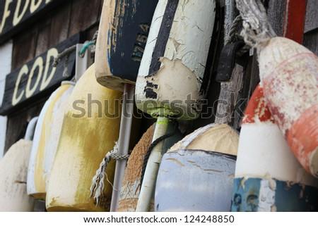 Buoys on a Cape Cod House - stock photo