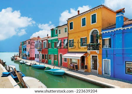 Burano island canal, colorful houses and boats, Italy.  - stock photo