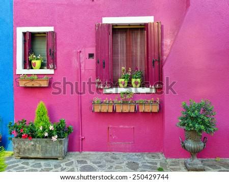 Burano island, Venice. Decorated facade of the house. Colorful houses island and landmark of Veneto region, Italy - stock photo