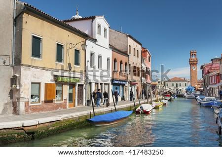 BURANO, ITALY - MAY 08, 2014: Tourist on the famous island Murano, Venice, Italy. Venice and the Venetian lagoon are on the UNESCO World Heritage List. - stock photo