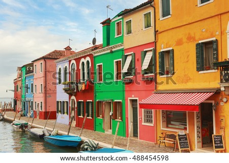 Burano, Italy - September 17, 2016 : Colorful houses of Bruno island in Venice.Everyday hundreds of tourists visit the island and enjoy the peaceful and beautiful atmosphere.