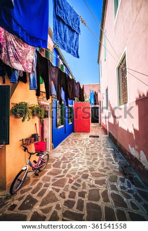 BURANO, VENICE, ITALY - AUGUST 20: Usual life of the local people in the touristic famous place on August 20, 2015 on Burano island, province of Venice, Italy - stock photo