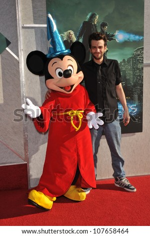 "BURBANK, CA - JULY 12, 2010: Jay Baruchel & Mickey Mouse at a benefit screening for his new movie ""The Sorcerer's Apprentice"" at Walt Disney Studios. - stock photo"