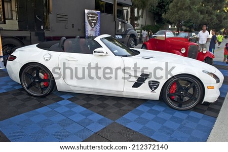 BURBANK/CALIFORNIA - JULY 26, 2014: 2014 Mercedes convertible customized by West Coast Customs on display at the Burbank Car Classic July 26, 2014, Burbank, California USA  - stock photo