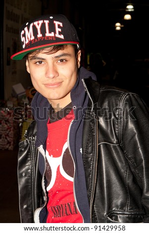 BURBANK - DEC 23: Kiowa Gordon receives a gift from Smyleithappens.com while attending Racers Edge Karting-Spark of Love Toy Drive, December 23, 2011 in Burbank, CA - stock photo