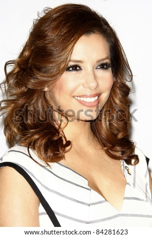BURBANK - MAR 20: Eva Longoria celebrates AT&T's $1 Million donation to PADRES Contra El Cancer with an extra large $300.000 check in Burbank, California on March 20, 2010