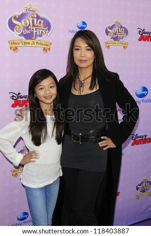 BURBANK - NOV 10: Ming-Na, daughter Michaela at the premiere of Disney Channels' 'Sofia The First: Once Upon a Princess' at Walt Disney Studios on November 10, 2012 in Burbank, California