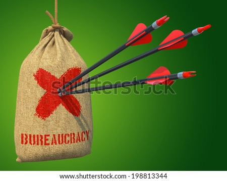 Bureaucracy - Three Arrows Hit in Red Target on a Hanging Sack on Green Bokeh Background. - stock photo