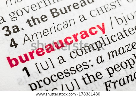 Bureaucracy Word Definition In Dictionary Close Up - stock photo