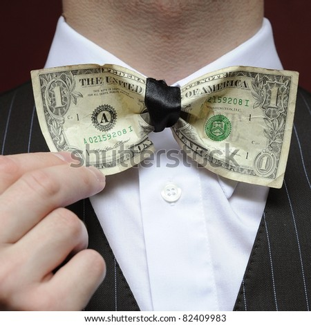bureaucrat with bowtie made from dollar note - stock photo