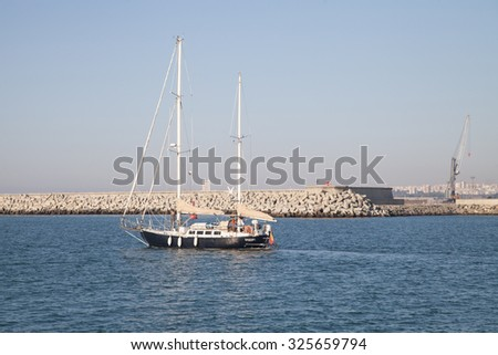 Burgas - August 28: A yacht with two crew set sail from the port of August 28, 2015 Bourgas, Bulgaria