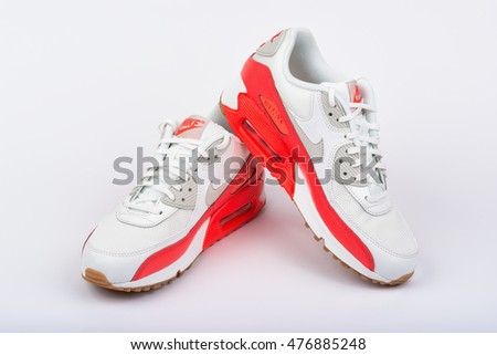 BURGAS, BULGARIA - AUGUST 29, 2016: Nike Air MAX lady's - women's shoes - sneakers - trainers, in white and orange, illustrative editorial, over Nike shoes box, on white background