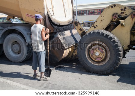 Burgas, Bulgaria - August 29: On the job site - laying asphalt on city street of workers and road construction machinery on August 29, 2015 Burgas, Bulgaria