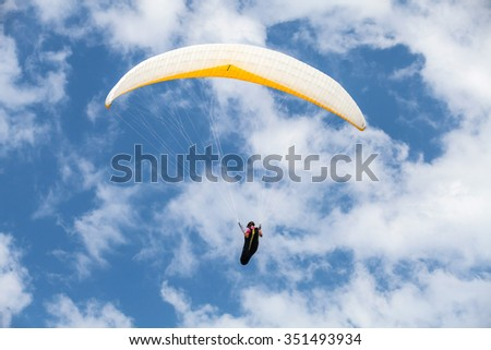Burgas, Bulgaria - July 23, 2014: Amateur paraglider in blue cloudy sky