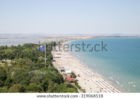 Burgas - July 25: Aerial photos. Bay with beach, sea garden, ships, lighthouse with harbor in the background of blue sky on July 25, 2015, Burgas, Bulgaria