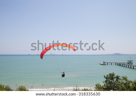 Burgas - July 24: Competition Accuracy landing paragliding - paraglider red against the blue sky and sea, July 24 to 26, 2015 to July 24, 2015, Burgas, Bulgaria