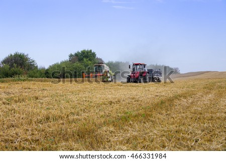 Burgas - July 4: Harvest - harvester and tractor trailer harvest of wheat field July 4, 2016, Burgas, Bulgaria