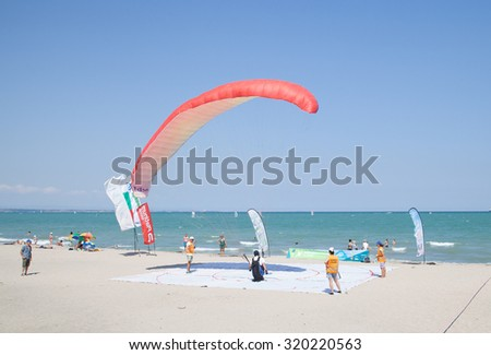 Burgas - July 24: Race suit landing paraglider - orange paraglider lands in the goal on the beach on July 24 to 26, 2015 July 24, 2015, Burgas, Bulgaria