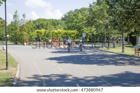 Burgas - July 9: Seaside Park - biking and walking paths with cyclists and pedestrians against the blue sky with white clouds  on July 9, 2016, Burgas, Bulgaria
