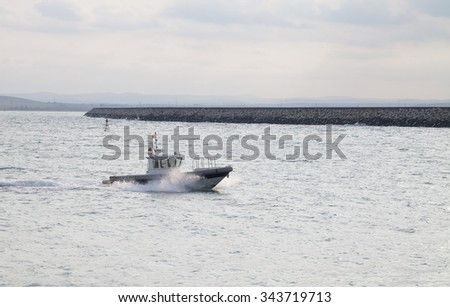 Burgas - October 27: A small boat enters the port of October 27, 2015, Burgas, Bulgaria