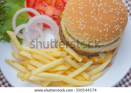 Burger and chip. - stock photo