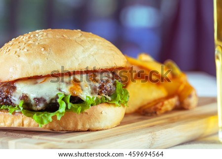 burger and french fries on wooden table