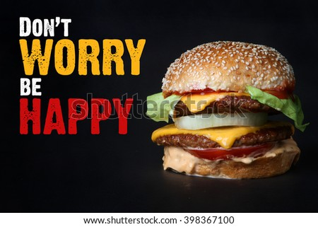 burger beef with potatoes  American junk fast food hamburger with cheese cheeseburger don't worry be happy - stock photo