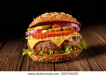 Burger. Burger on wooden background. Vintage burger. Home made burger. Fastfood meal. Pub burger. American style burger. Delicious burger. Gourmet burger. Burger on wooden table. Rustic burger, bun