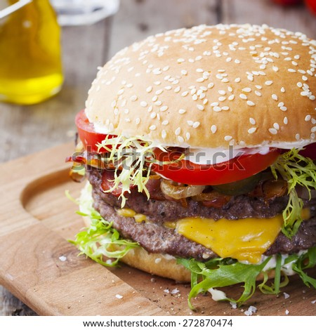 Burger, hamburger  with frech fries, ketchup, mustard and fresh vegetables on a dark wooden background - stock photo
