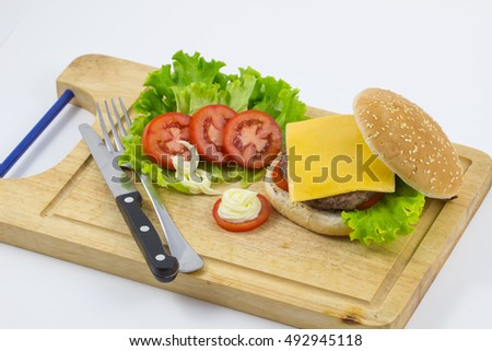 burger made from vegetables and beef on white background / hamburger with vegetables and fries on a wooden board, top view on white background.