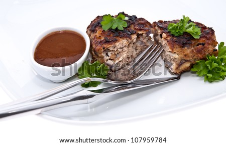 Burger on a plate with parsley isolated on white background - stock photo