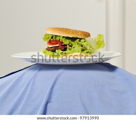 Burger on fat belly - stock photo