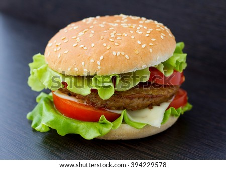 Guacamole beef burger melted cheese bacon stock photo for Table burger