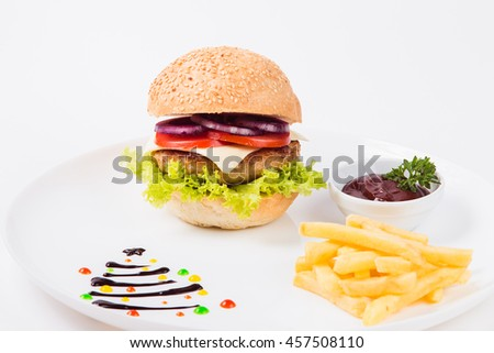 burger sauce and french fries on a white plate close up