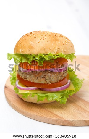 Burger with a vegetarian cutlet and fresh vegetables, close-up