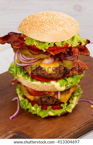 Burger With Beef, Bacon, Tomato, Cheese, Lettuce and Onion